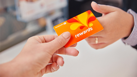 Woolworths Rewards card being used at the Caltex checkout
